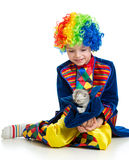 Kid boy clown with kitten inside hat over the white background Stock Images