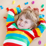 Kid boy with colorful numbers, indoor Royalty Free Stock Photography