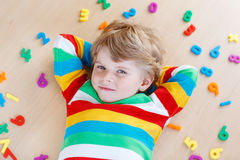 Kid boy with colorful numbers, indoor Stock Photos
