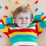 Kid boy with colorful numbers, indoor Stock Photography