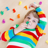 Kid boy with colorful numbers, indoor Royalty Free Stock Photos