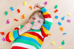 Kid boy with colorful numbers, indoor Stock Images