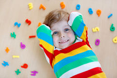Kid boy with colorful numbers, indoor Royalty Free Stock Photo
