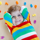 Kid boy with colorful numbers, indoor Royalty Free Stock Images