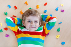 Kid boy with colorful numbers, indoor Stock Photo