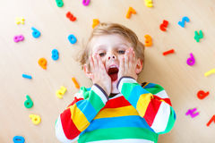Kid boy with colorful numbers, indoor Stock Image