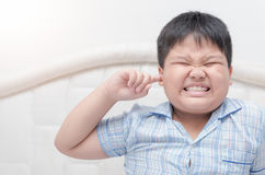 Kid boy covered ears the fingers and gesturing Royalty Free Stock Photos