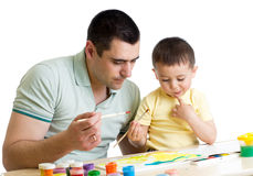 Kid boy and dad paint together. Child boy and father paint Royalty Free Stock Photo