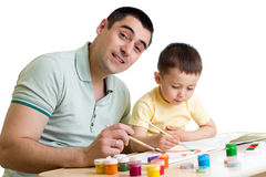 Kid boy and dad painting together isolated on white. Kid boy and dad paint together isolated on white Stock Images