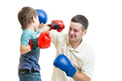Kid boy and dad play boxing Stock Photos