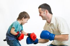 Kid boy and dad play boxing Royalty Free Stock Photo