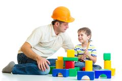 Kid boy and dad play builders. Isolated on white stock photo