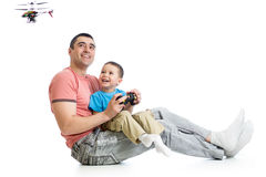 Kid boy and dad playing with RC helicopter toy Stock Images