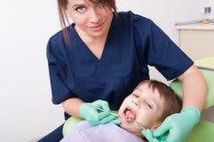 Kid or boy at dentist Stock Photos
