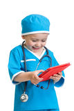 Kid boy doctor with tablet pc in hands Royalty Free Stock Photo