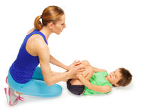 Kid boy doing physical exercises with his mom Stock Photography