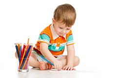 Kid boy drawing with colour pencils Royalty Free Stock Photography
