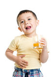 Kid boy drinking juice isolated on white backgroun Stock Image