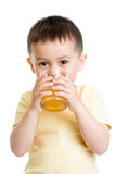 Kid boy drinking juice isolated Royalty Free Stock Photo