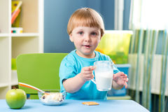 Kid boy drinking milk Stock Image