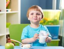 Kid boy drinking milk Royalty Free Stock Photos