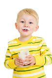 Kid boy drinking milk or yogurt. From glass isolated Stock Image
