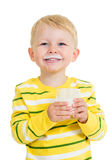 Kid boy drinking yoghurt or kefir Royalty Free Stock Photos