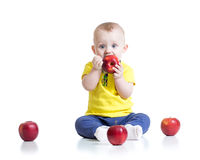 Kid boy eating apple, isolated on white Royalty Free Stock Photo