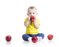 Kid boy eating apple, isolated on white Royalty Free Stock Photo