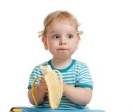 Kid boy eating banana isolated Royalty Free Stock Photos