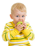 Kid boy eating green apple, isolated Stock Photo