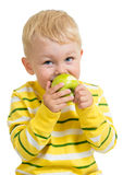 Kid boy eating green apple, isolated Royalty Free Stock Image