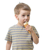 Kid boy eating ice cream isolated on white Stock Photos
