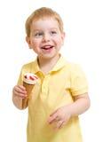 Kid boy eating ice cream isolated on white Stock Image