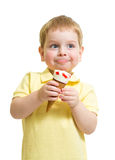 Kid boy eating ice cream with pleasure isolated Royalty Free Stock Photography