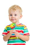Kid boy eating lollipop isolated. On white Royalty Free Stock Image