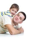 Kid boy embracing dad Royalty Free Stock Photography