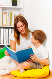 Kid boy enjoying story telling by his mother Stock Photography