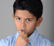 Kid. Boy with face expression thinking Stock Image