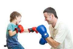Kid boy and father play boxing Stock Images