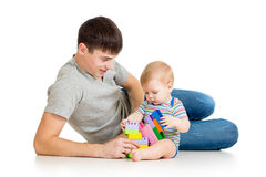 Kid boy and father play together Royalty Free Stock Photos