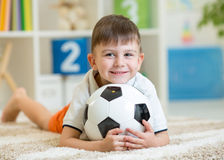Kid boy with football  indoor Stock Photos