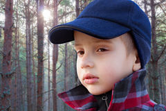 Kid boy forest fashion portrait checked coat cap Royalty Free Stock Photos