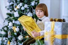 Kid boy with gift royalty free stock photography