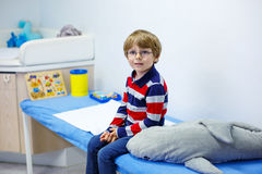 Kid boy with glasses waiting for check-up of Stock Images