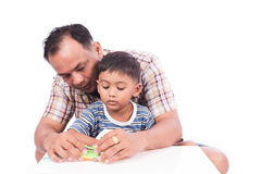 Kid boy and his dad assembly  toy car Royalty Free Stock Image