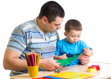 Kid boy and his dad play together Stock Image