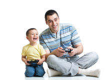 Kid boy and his dad playing with a playstation together Royalty Free Stock Photo