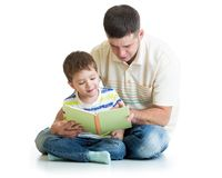 Kid boy and his dad read a book. Together Royalty Free Stock Image