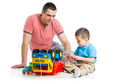 Kid boy and his dad repair toy trunk Stock Images